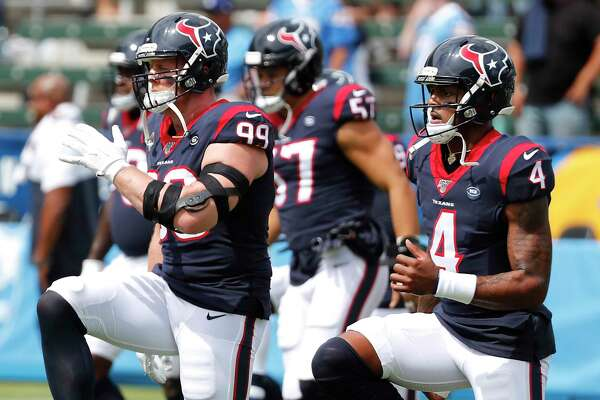 Houston Texans defensive end J.J. Watt (99) and quarterback Deshaun Watson (4) warm up side-by-side before and NFL game against the Los Angeles Chargers at Dignity Health Sports Park on Sunday, Sept. 22, 2019, in Carson, Calif.