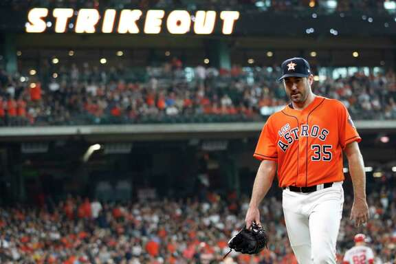 Houston Astros starting pitcher Justin Verlander (35) walks back to the dugout after striking out Los Angeles Angels Kole Calhoun in the fifth inning of an MLB baseball game at Minute Maid Park, Sunday, Sept. 22, 2019, in Houston.