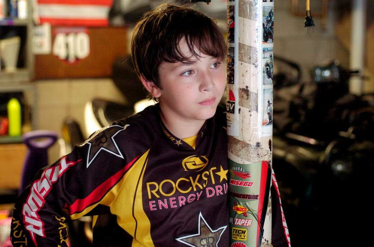Dalen Vernazza, 11, who races motorcycles in the garage of his Thornridge Road home in Stamford, Conn. on Thursday August 5, 2010.