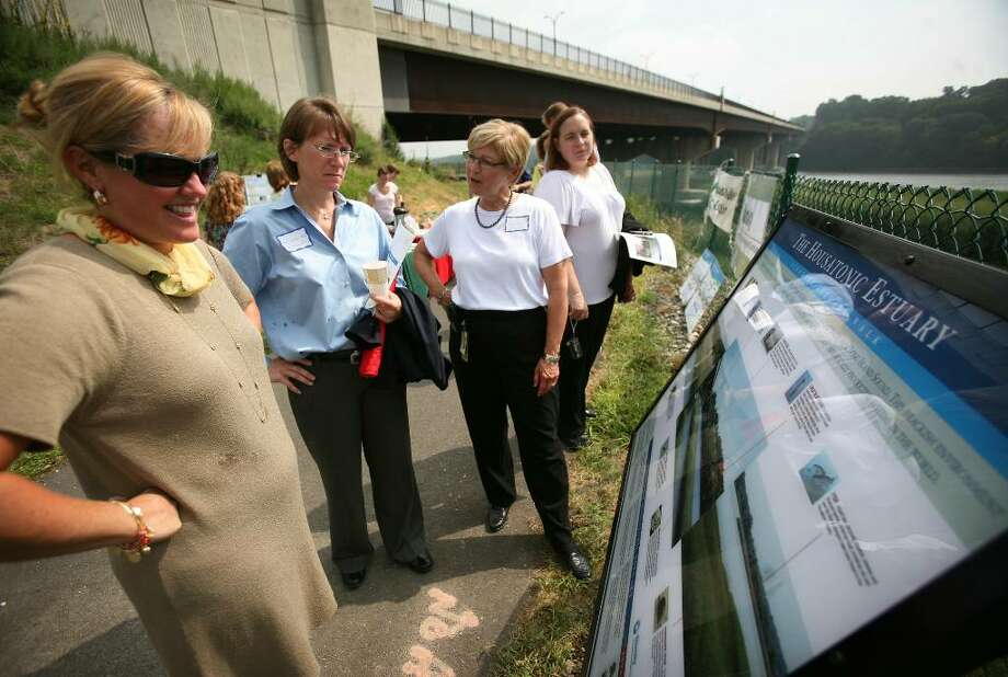 From left; Susan Hitchcock of Sikorsky, Amy Jackson-Grove of the Federal Highway Administration, and Linda Barlow of Sikorsky, check out the new signage on the Housatonic Estuary Walk during an unveiling ceremony on Thursday, August 5, 2010. Photo: Brian A. Pounds / Connecticut Post