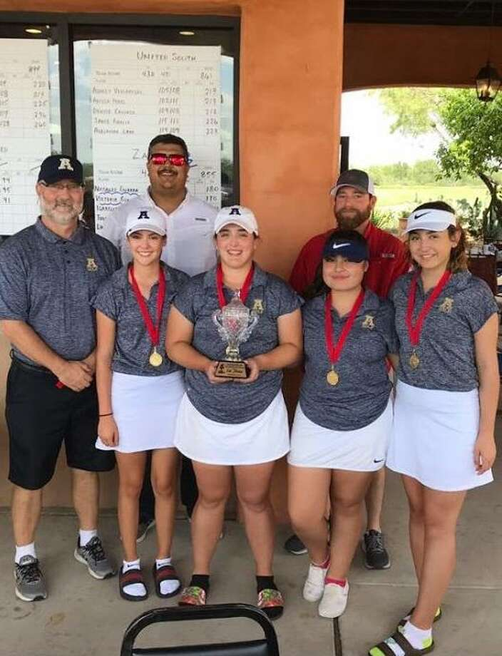 Alexander is pictured with Border Olympics directors Matt Groogan andd Marcus Cantu after winning the tournament title Saturday. From left in the front are Catherine Flores, Sara Salido, Zaida Gonzalez and Daniella Morales. Photo: Courtesy Photo