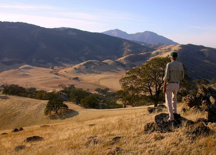 Ned MacKay, with more than 20,000 trail miles as a member of the regional parks' Volunteer Safety Patrol, at one of his favorite rocks on Hardy Canyon Trail for this view of Mount Diablo. Photo: Tom Stienstra / The Chronicle