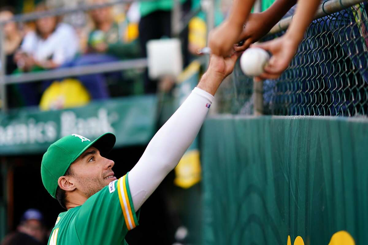 OAKLAND, CALIFORNIA - SEPTEMBER 20: Matt Olson #28 of the Oakland Athletics signs autographs prior to the game against the Texas Rangers at Ring Central Coliseum on September 20, 2019 in Oakland, California. (Photo by Daniel Shirey/Getty Images)