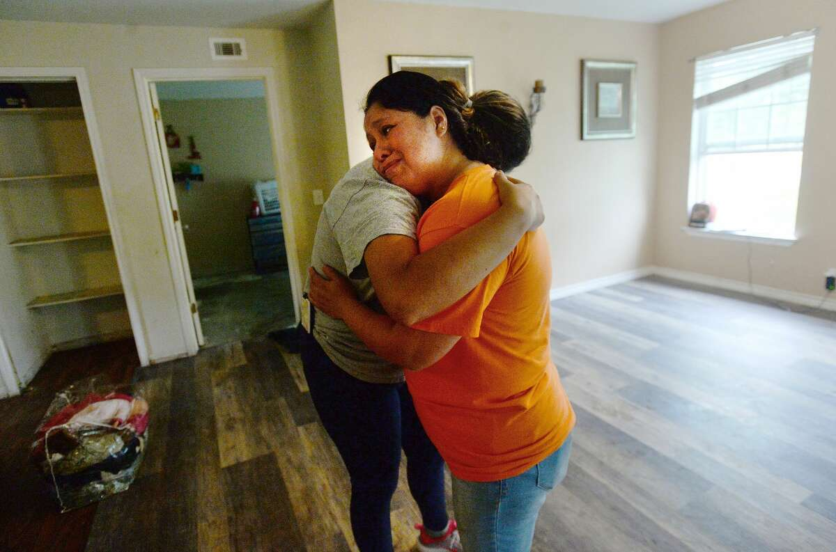 Yesenia Sanchez (in orange) gets a hug from Marcella Gorrostieta as she becomes emotional while cleaning up the Sanchez's flood damaged home on Avenue H in Beaumont as the process of recovery from Imelda's torrential rains and flooding begins throughout the region Friday. Photo taken Friday, September 20, 2019 Kim Brent/The Enterprise