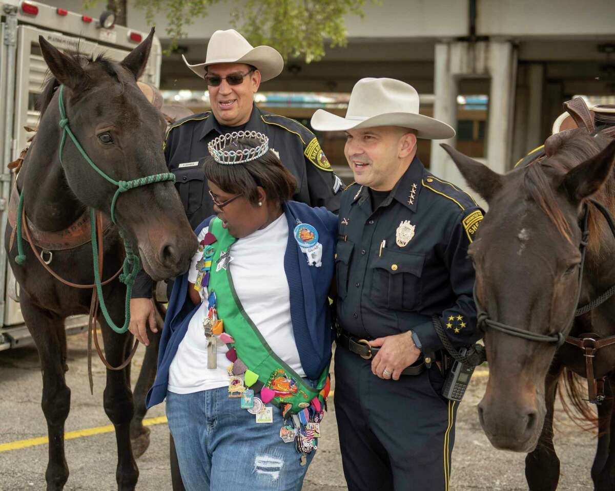 Jordan C. Allen, 17, the Fiesta Especial Duchess for 2018, reacts as a Bexar County Sheriff Department horse gives her a nudge while she poses for photos with Bexar County Sheriff Javier Salazar during the inaugural abilitySTRONG Parade on Oct. 20, 2018.