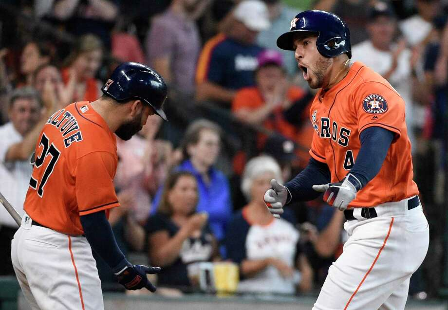 Houston Astros' George Springer, right, celebrates his solo home run off Los Angeles Angels relief pitcher Jose Suarez with Jose Altuve during the fourth inning of a baseball game, Sunday in Houston. It was Springer's third home run of the game. Photo: Eric Christian Smith, FRE / Associated Press / Copyright 2019 The Associated Press. All rights reserved.
