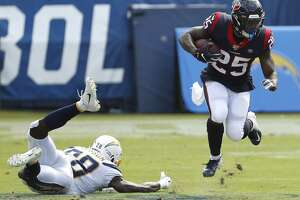 Houston Texans running back Duke Johnson (25) leaps away from Los Angeles Chargers defensive back Brandon Facyson (28) during the second quarter of an NFL football game at Dignity Health Sports Park on Sunday, Sept. 22, 2019, in Carson, Calif.