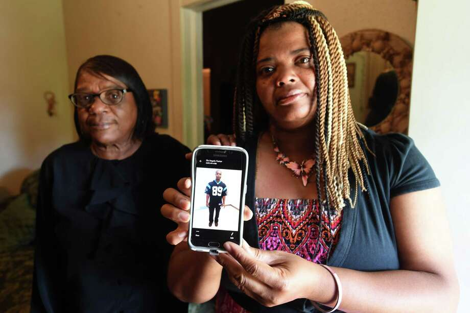 Angela Foster holds a picture of her brother Malcom Foster who was killed by flooding from Tropical Depression Imelda. Angela's aunt Janet Foster is also pictured.  Photo taken Saturday, 9/21/19 Photo: Guiseppe Barranco/The Enterprise / Guiseppe Barranco/The Enterprise/ / Guiseppe Barranco ©