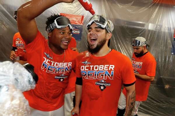 Houston Astros Framber Valdez pours beer on Roberto Osuna as the team celebrated the team's win and clinching the AL West crown after an MLB baseball game at Minute Maid Park, Sunday, Sept. 22, 2019, in Houston.