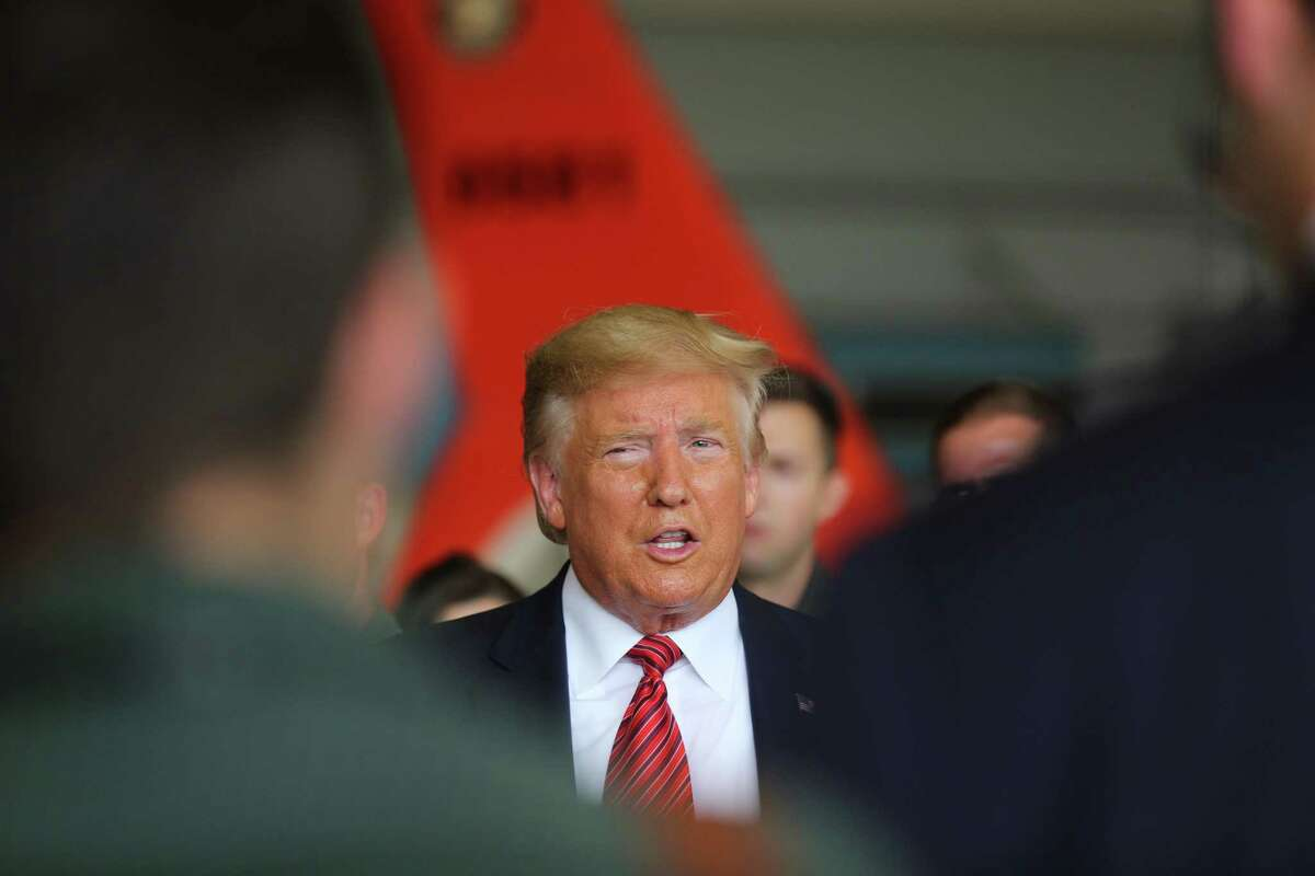 President Donald Trump answers questions during a stop at the Coast Guard in Ellington Field Joint Reserve Base, Sunday, Sept. 22, 2019 in Houston.