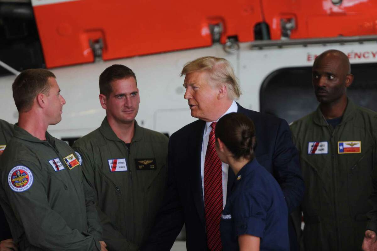 President Donald Trump meets with members of the Coast Guard in Ellington Field Joint Reserve Base, Sunday, Sept. 22, 2019 in Houston.