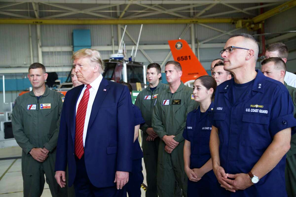 President Donald Trump answers question from the press during a stop to greet members of the Coast Guard in Ellington Field Joint Reserve Base, Sunday, Sept. 22, 2019 in Houston.