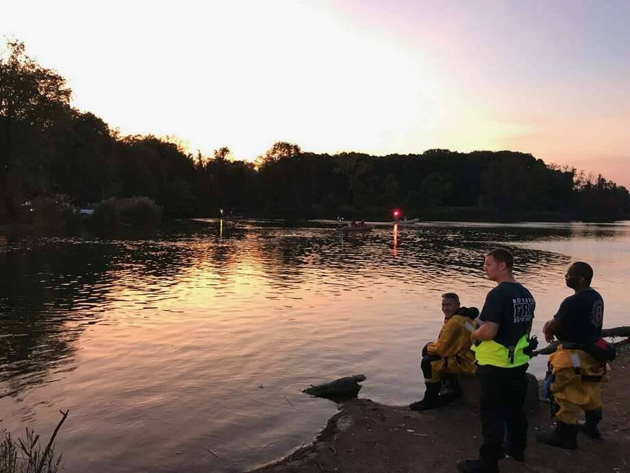 Police and fire officials in West Haven and New Haven were searching for a person who went under water in the West Riveron Sept. 22, 2019. Photo: Rick Fontana / Contributed