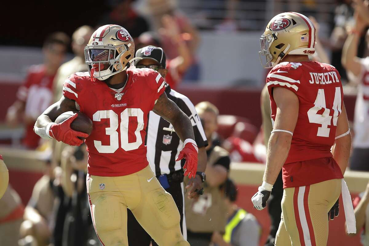 San Francisco 49ers running back Jeff Wilson Jr. (30) scores a touchdown against the Pittsburgh Steelers during the second half of an NFL football game in Santa Clara, Calif., Sunday, Sept. 22, 2019. (AP Photo/Ben Margot)