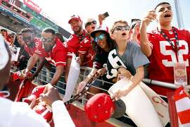 San Francisco 49ers' fans yell to Mike McGlinchy as Deebo Samuel signs autographs before Niners play Pittsburgh Steelers in NFL game at Levi's Stadium in Santa Clara, Calif., on Sunday, September 22, 2019.