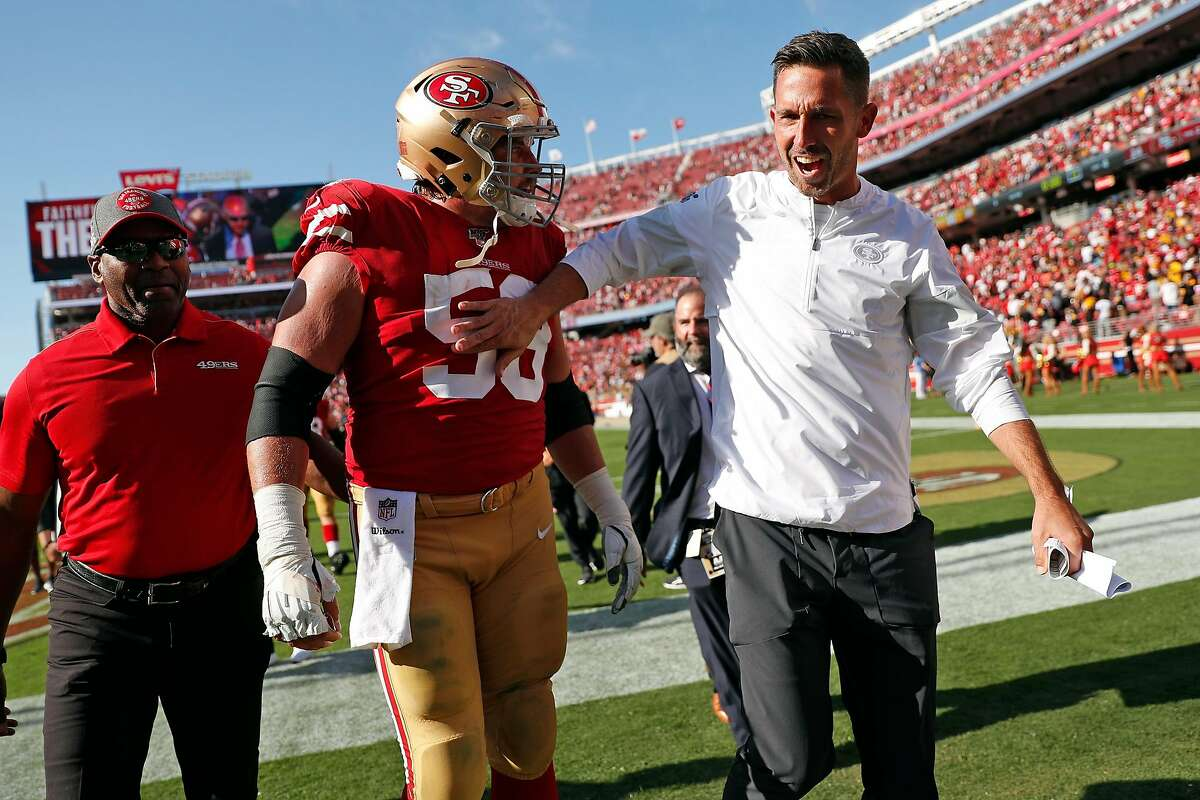 San Francisco 49ers' head coach Kyle Shanahan and Weston Richburg celebrate after Niners' 24-20 win over Pittsburgh Steelers in NFL game at Levi's Stadium in Santa Clara, Calif., on Sunday, September 22, 2019.