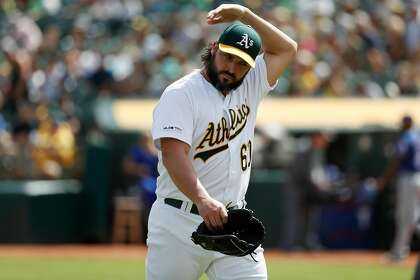 A's lose home finale, hit road for final week