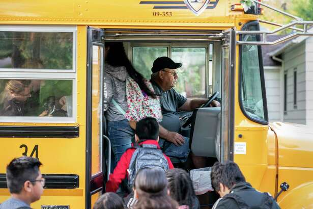 Don Brink picks up students on his route in Worthington, Minn. The town has seen an influx of undocumented children, but Brink does not support a plan to expand local schools.