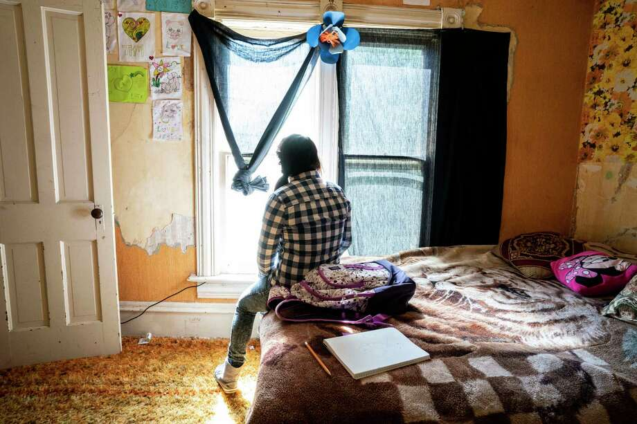 A 16-year-old from Guatemala sits in her bedroom in Worthington, Minnesota, on Sept. 4, 2019. Photo: Photo For The Washington Post By Courtney Perry. / Courtney Perry