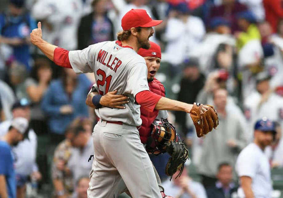 Cardinals pitcher Andrew Miller celebrates with catcher Yadier Molina after defeating the the Chicago Cubs in a game Sunday in Chicago. The win gave the Cards a four-game series sweep and clinched a postseason berth for St. Louis. Photo: Associated Press