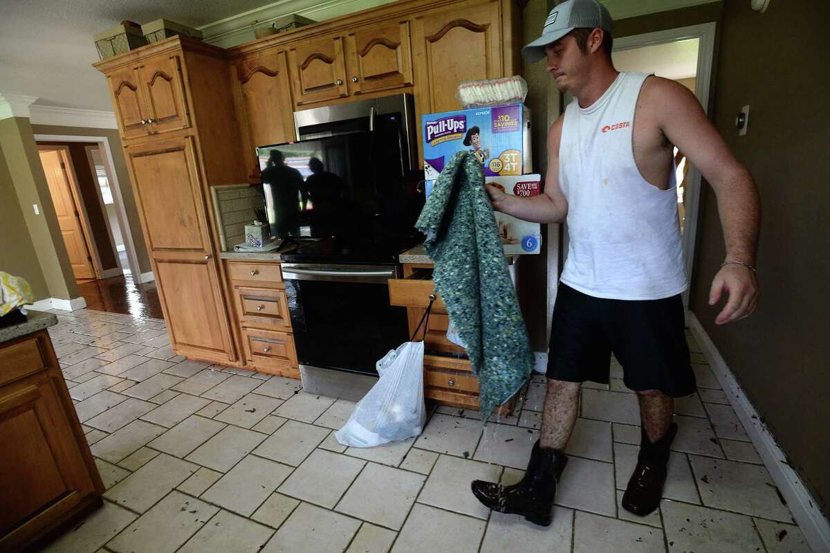 Blake Harvey carries a piece of flooded carpet while helping clean out his friend Jarrad McClelland's flooded home in Vidor as the process of recovery from Imelda's torrential rains and flooding begins throughout the region Friday. Photo taken Friday, September 20, 2019 Kim Brent/The Enterprise