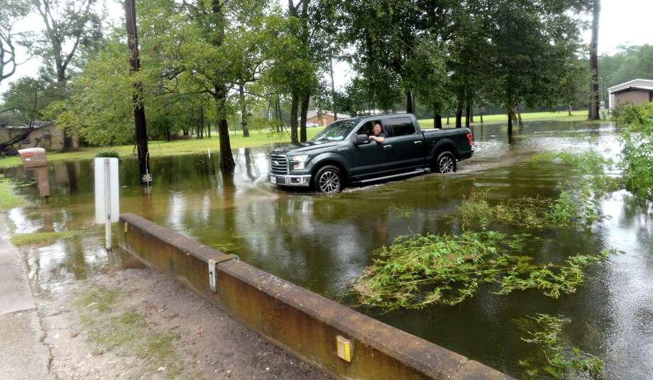 A truck slowly makes its way through a flooded yard and driveway on Sargent in Vidor as the process of recovery from Imelda's torrential rains and flooding begins throughout the region Friday. Photo taken Friday, September 20, 2019 Kim Brent/The Enterprise Photo: Kim Brent / The Enterprise / BEN