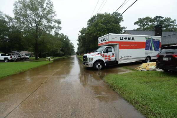 A U-Haul truck sits outside the Crift home in Vidor as the process of recovery from Imelda's torrential rains and flooding begins throughout the region Friday. Photo taken Friday, September 20, 2019 Kim Brent/The Enterprise