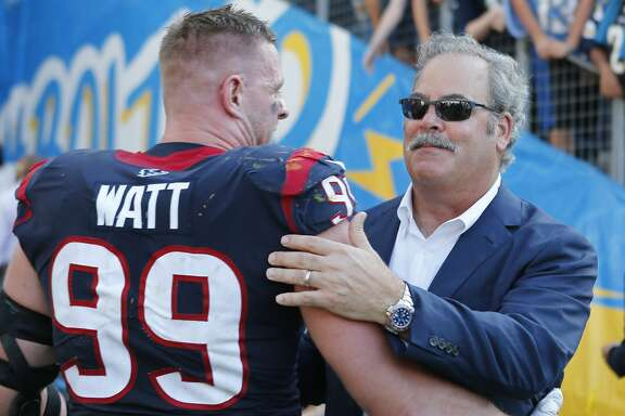 Houston Texans defensive end J.J. Watt (99) embraces Texans chairman and CEO Cal McNair after the Texans 27-20 win over the Los Angeles Chargers at Dignity Health Sports Park on Sunday, Sept. 22, 2019, in Carson, Calif.