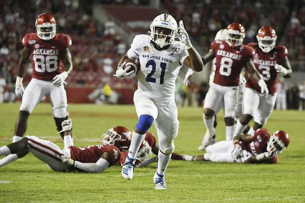 San Jose State running back DeJon Packer breaks through the Arkansas defense to score a touchdown during the second half of an NCAA college football game Saturday, Sept. 21, 2019, in Fayetteville, Ark. (AP Photo/Michael Woods)