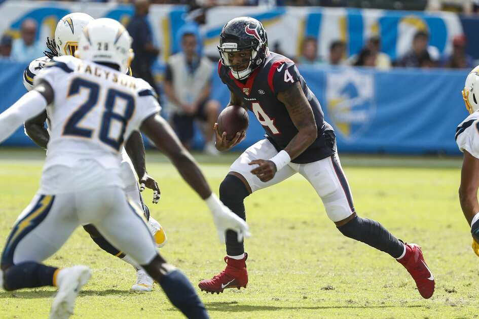 Houston Texans quarterback Deshaun Watson (4) runs out of the pocket past Los Angeles Chargers defensive back Roderic Teamer (36) during the second quarter of an NFL football game at Dignity Health Sports Park on Sunday, Sept. 22, 2019, in Carson, Calif.