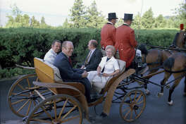 President Gerald Ford, second from left, Michigan Gov. William Milliken, Marjorie Griffin and Dick Keiser, ride a horse-drawn carriage on July 13, 1975, while visiting Mackinac Island, Michigan.