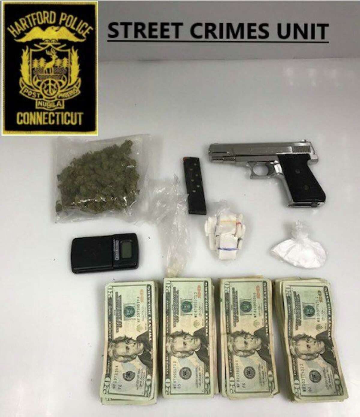 Hartford Police seized cash, a gun and a significant amount of drugs during a traffic stop.