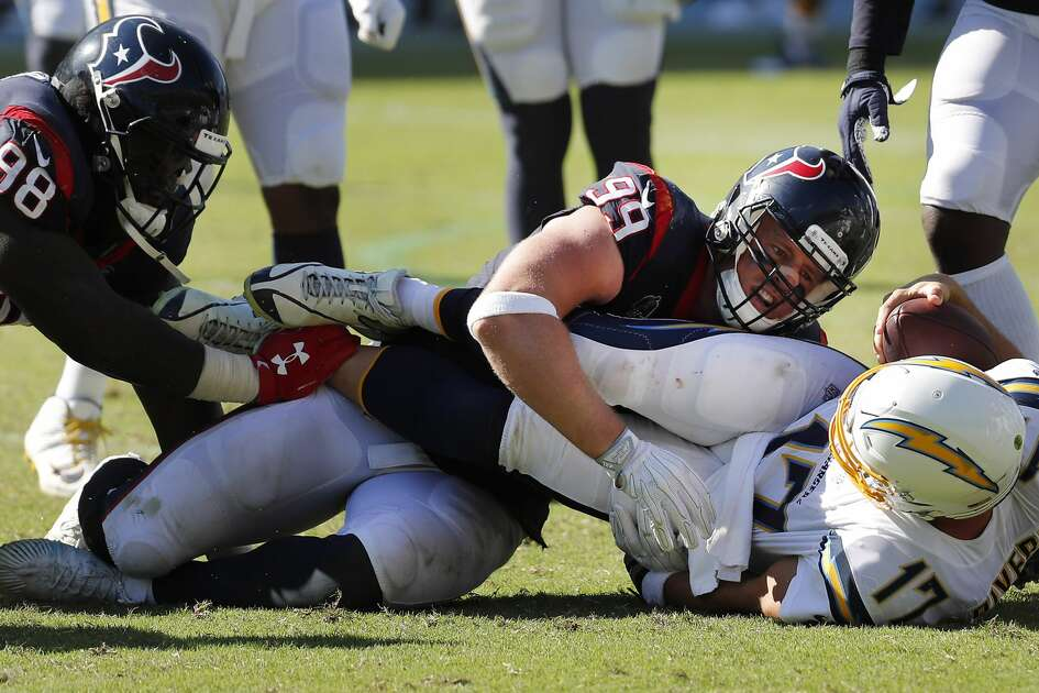 Houston Texans defensive ends D.J. Reader (98) and J.J. Watt (99) sack Los Angeles Chargers quarterback Philip Rivers (17) during the third quarter of an NFL football game at Dignity Health Sports Park on Sunday, Sept. 22, 2019, in Carson, Calif.