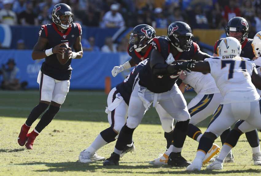 Houston Texans quarterback Deshaun Watson (4) drops back to pass behind his offensive line against the Los Angeles Chargers during the fourth quarter of an NFL football game at Dignity Health Sports Park on Sunday, Sept. 22, 2019, in Carson, Calif.
