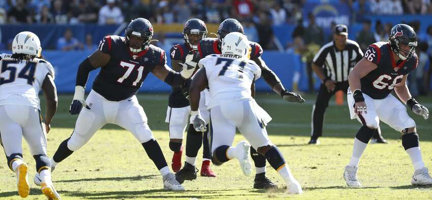 Houston Texans offensive tackle Tytus Howard (71) and center Nick Martin (66) drop back to pass block for quarterback Deshaun Watson (4) against the Los Angeles Chargers during the fourth quarter of an NFL football game at Dignity Health Sports Park on Sunday, Sept. 22, 2019, in Carson, Calif.