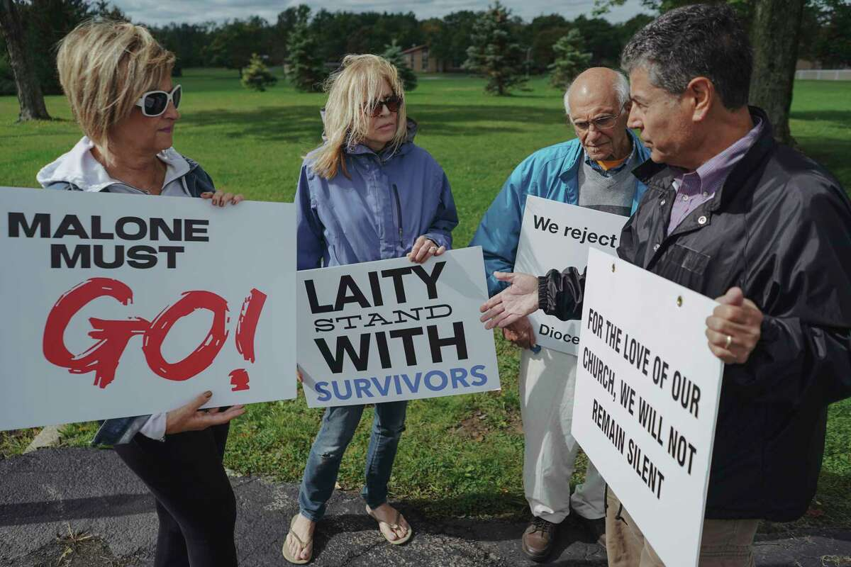 Protesters call for the resignation of Bishop Richard Malone of Buffalo, outside Christ the King Seminary in East Aurora, N.Y., Sept. 14, 2019. Malone has been embroiled in scandal over his handling of clergy sexual abuse and despite revelations from whistle-blowers and calls from lay leaders and priests for him to step down, Malone has declined to do so. (Libby March/The New York Times)