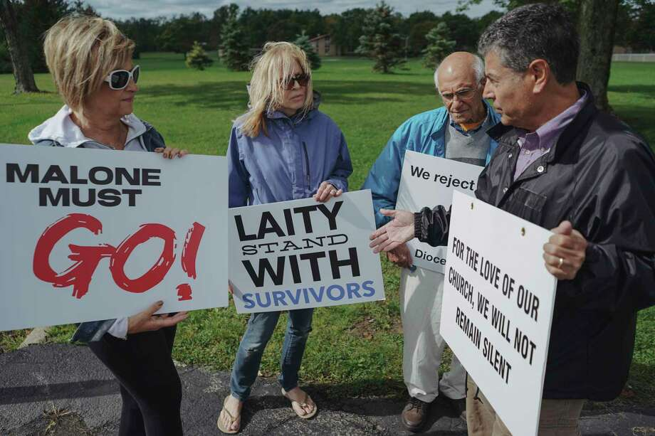 Protesters call for the resignation of Bishop Richard Malone of Buffalo, outside Christ the King Seminary in East Aurora, N.Y., Sept. 14, 2019. Malone has been embroiled in scandal over his handling of clergy sexual abuse and despite revelations from whistle-blowers and calls from lay leaders and priests for him to step down, Malone has declined to do so. (Libby March/The New York Times) Photo: LIBBY MARCH / NYTNS