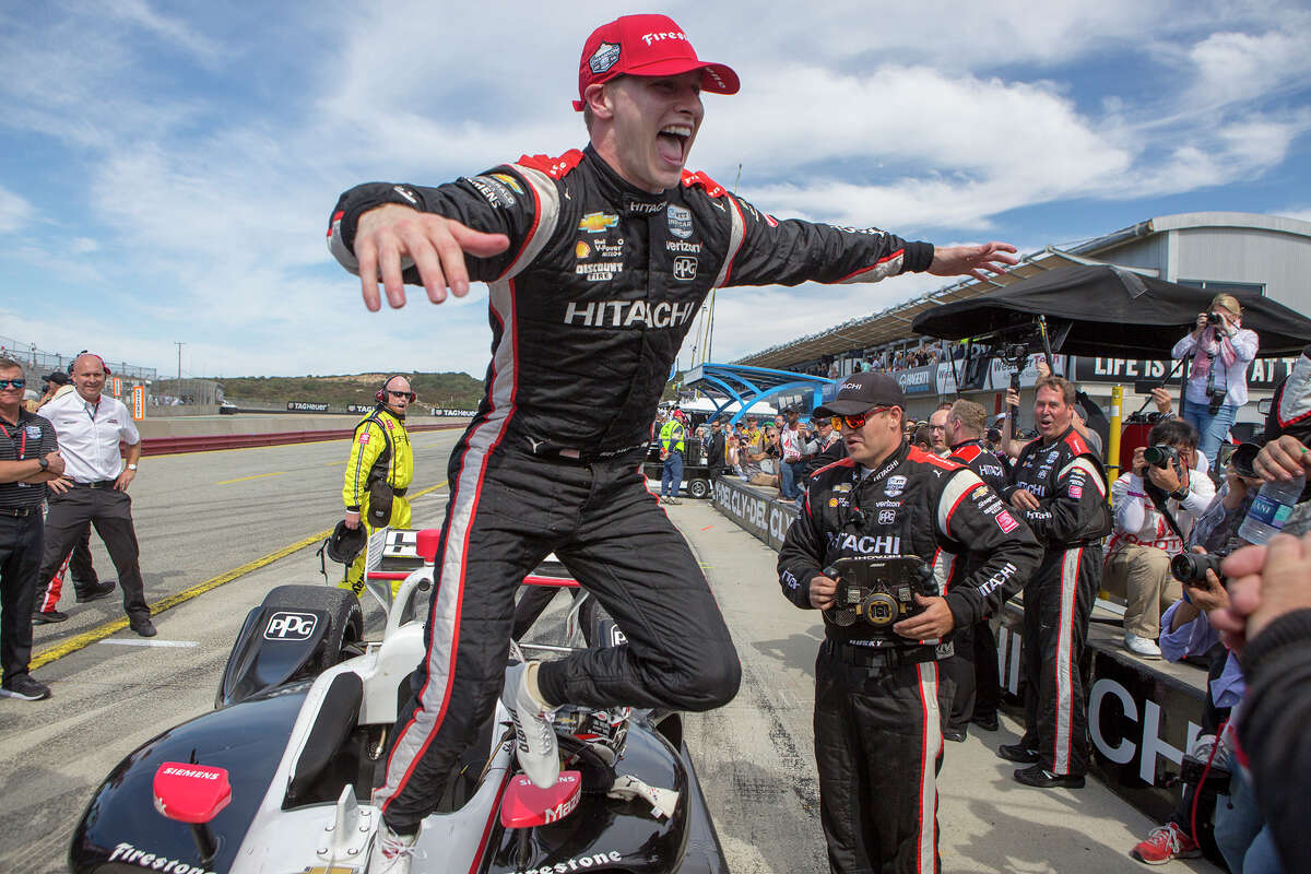 Josef Newgarden (2) jumps from his car to celebrate with his team after winning an IndyCar auto race at Laguna Seca Raceway in Monterey, Calif., Sunday, Sept. 22, 2019. (AP Photo/David Royal)