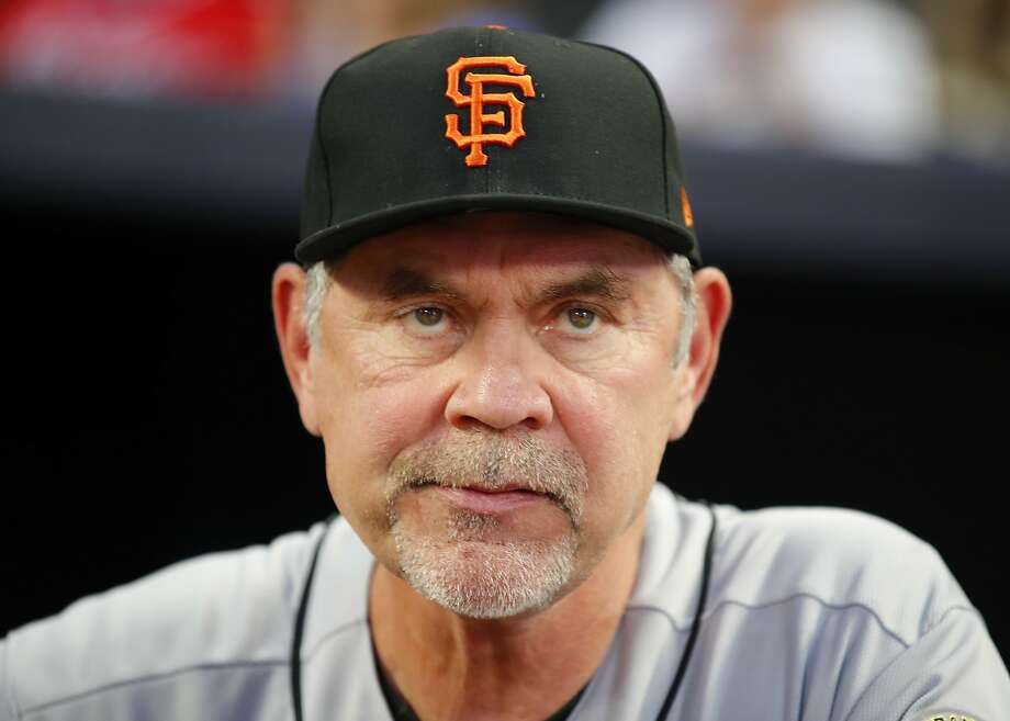 Among other things, Bruce Bochy is known for his enormous head. He wears an 8-1/8-size hat. Photo: Todd Kirkland, Getty Images