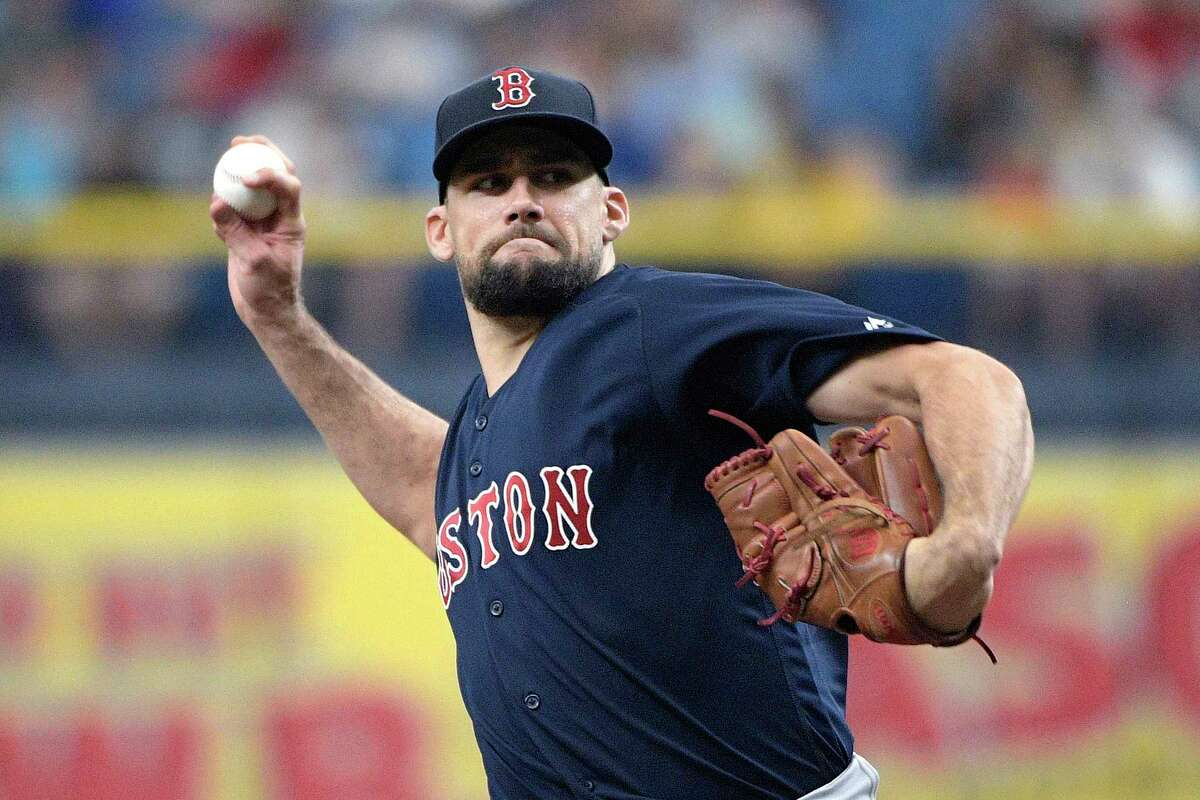 Boston Red Sox starting pitcher Nathan Eovaldi throws during the first inning of a baseball game against the Tampa Bay Rays, Sunday, Sept. 22, 2019, in St. Petersburg, Fla. (AP Photo/Phelan M. Ebenhack)