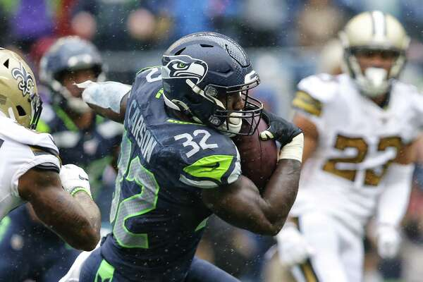 Seattle Seahawks running back Chris Carson (32) funds a hole in the second quarter of Seattle's game against the New Orleans Saints, Sunday, Sept. 22, 2019. The Seahawks lost 33-27.