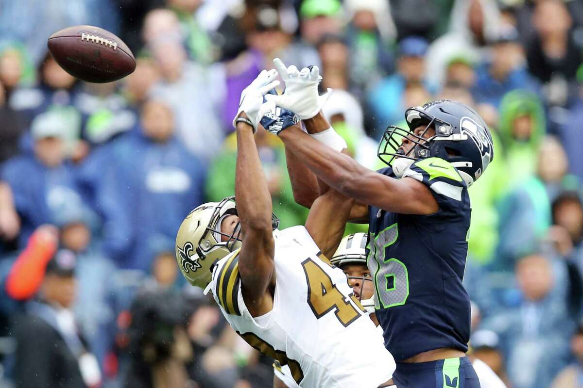 New Orleans Saints safety Marcus Williams (43) breaks up an endzone pass intended for Seattle Seahawks wide receiver Tyler Lockett (16) in the third quarter of Seattle's game against the New Orleans Saints, Sunday, Sept. 22, 2019. The Seahawks lost 33-27.