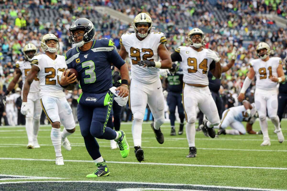 Seattle Seahawks quarterback Russell Wilson (3) scrambles for an 8-yard touchdown during the fourth quarter of Seattle's game against the New Orleans Saints, Sunday, Sept. 22, 2019. The Seahawks lost 33-27.