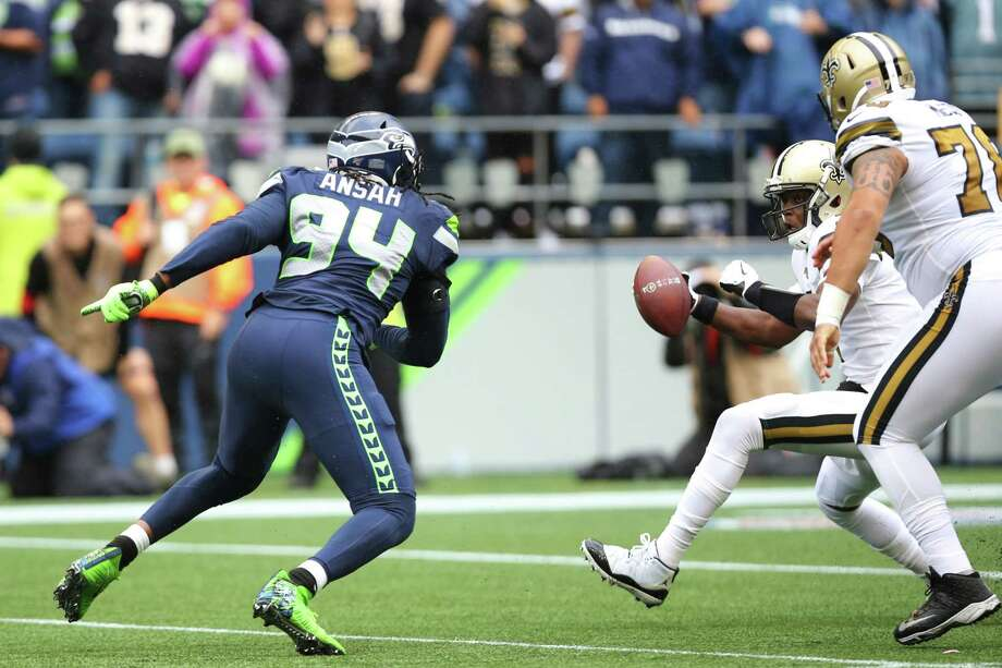 Seattle Seahawks defensive end Ziggy Ansah (94) goes after New Orleans Saints quarterback Teddy Bridgewater (5) during Seattle's game against the New Orleans Saints, Sunday, Sept. 22, 2019. The Seahawks lost 33-27. Photo: Genna Martin, Seattlepi.com / GENNA MARTIN