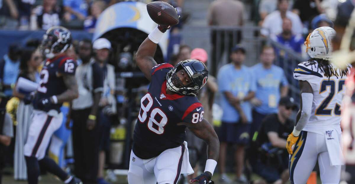 Houston Texans tight end Jordan Akins (88) spikes the ball after scoring on a 15-yard touchdown reception against the Los Angeles Chargers during the third quarter of an NFL football game at Dignity Health Sports Park on Sunday, Sept. 22, 2019, in Carson, Calif.