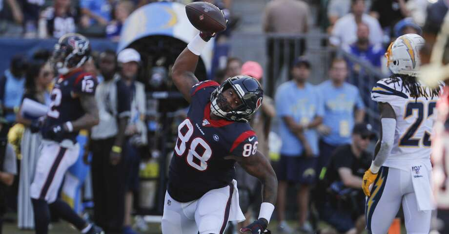 Houston Texans tight end Jordan Akins (88) spikes the ball after scoring on a 15-yard touchdown reception against the Los Angeles Chargers during the third quarter of an NFL football game at Dignity Health Sports Park on Sunday, Sept. 22, 2019, in Carson, Calif. Photo: Brett Coomer/Staff Photographer