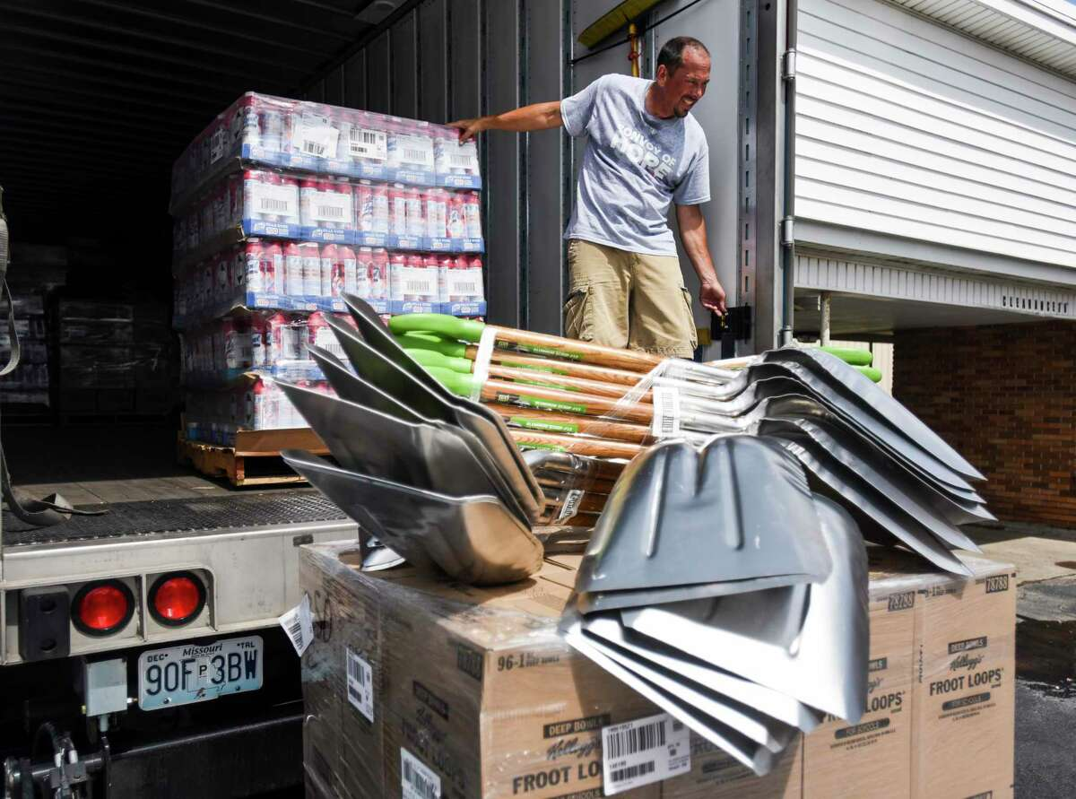 Kevin Binam, with Convoy of Hope, unloads various supplies from the truck at First Baptist Church on Sunday in Winnie. Photo taken on Sunday, 09/22/19. Ryan Welch/The Enterprise