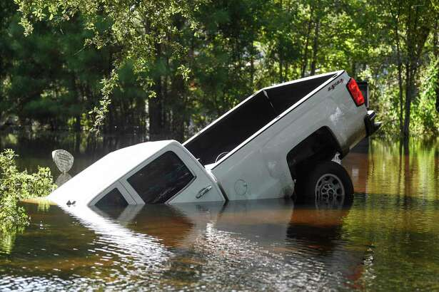 A truck lays halfway submerged off of flooded Texas 124 near Fannett Sunday. Photo taken on Sunday, 09/22/19. Ryan Welch/The Enterprise