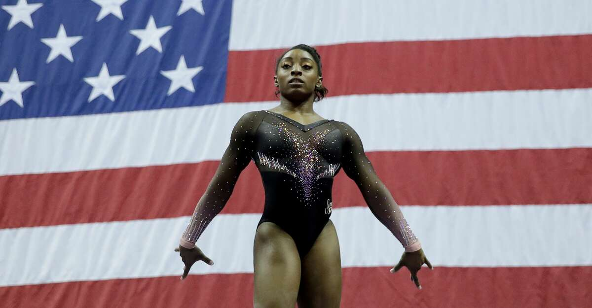 Simone Biles, competing in last year's national championships in Kansas City, will have to wait another year to defend the four gold medals she won.