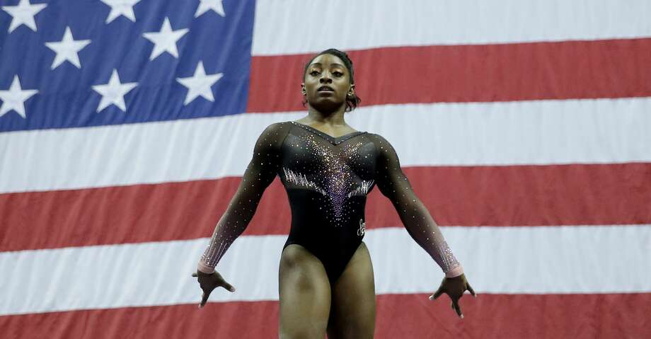 Simone Biles competes on the beam during the senior women's competition at the 2019 U.S. Gymnastics Championships Sunday, Aug. 11, 2019, in Kansas City, Mo. (AP Photo/Charlie Riedel) Photo: Charlie Riedel/Associated Press